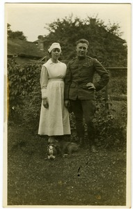 Thumbnail of Lawrence D. Yeomans, in uniform, standing with unidentified nurse and bulldog