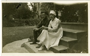 Thumbnail of Lawrence D. Yeomans, in uniform, seated on steps with unidentified nurse