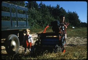 Thumbnail of Becky and Fred Cann with Western picker and bog truck, Duxbury Cranberry Company