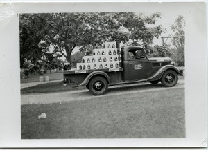 Thumbnail of Duxbury Cranberry Company truck and float for Fourth of July parade Company name painted on the door of the truck, which is loaded with cranberry             juice bottles
