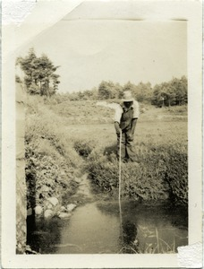 Thumbnail of Duxbury Cranberry Company: Jo Smith, resident and employee: poking in a drainage         ditch