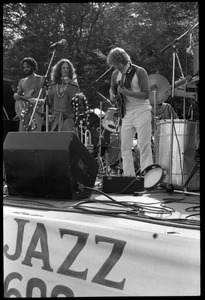 Thumbnail of Flora Purim (microphone) and band performing at Jazz Festival, Hampshire College