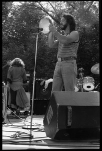 Thumbnail of Airto Moreira on tambourine, Flora Purim (back to camera), and band performing at Jazz Festival, Hampshire College