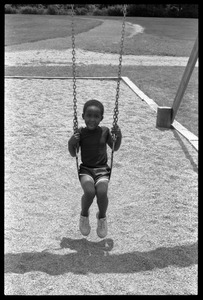 Thumbnail of Child on a swingset