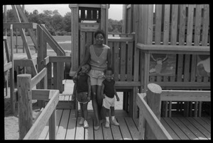 Thumbnail of Irma McClaurin with two children atop playground equipment