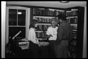 Thumbnail of Eugene Terry (center) conversing with unidentified woman and Richard Hall in front of bookshelves, at the book party for Robert H. Abel