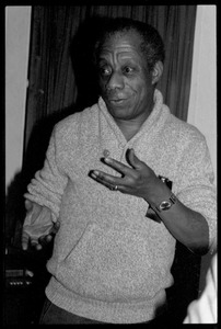 Thumbnail of James Baldwin: informal portrait, gesturing, at the book party for Robert H. Abel