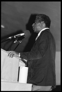 Thumbnail of James Baldwin lecturing at UMass Amherst Baldwin standing at a podium with microphones