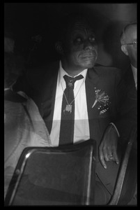 Thumbnail of James Baldwin seated in the audience at his birthday celebration