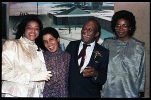 Thumbnail of James Baldwin with (r. to l.) Irma McClaurin, Carlie Tartakov, and Onita             Estes-Hicks at his 60th birthday celebration, UMass Campus Center