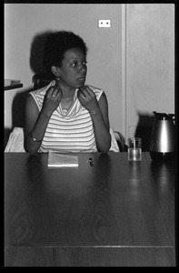 Thumbnail of Nancy Morejón, Cuban writer, speaking at the Institute for the Humanities, UMass Amherst, seated at a table for             discussion