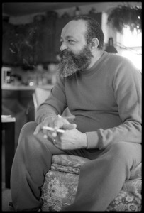 Thumbnail of Andrew Salkey: three-quarter length portrait seated, with cigarette