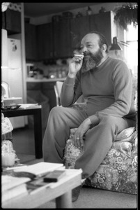Thumbnail of Andrew Salkey: full length portrait seated, smoking