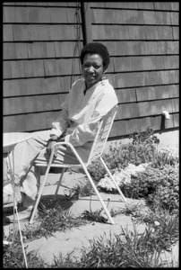 Thumbnail of Cuban writer Nancy Morejón, seated in a lawn chair behind a house