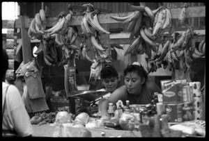 Thumbnail of Woman operating a market stall in the old marketplace selling produce, Belize City