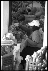 Thumbnail of Woman selling produce in the new marketplace, Belize City