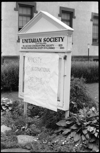 Thumbnail of Sign for the Unitarian Society of Florence and Northampton, Main Street, with             notice of tag sale for the benefit of Amnesty International