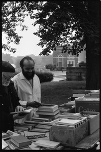 Thumbnail of Thomas C. Crowe (?) and Andrew Salkey looking over books at a tag sale at the Unitarian Society, Northampton