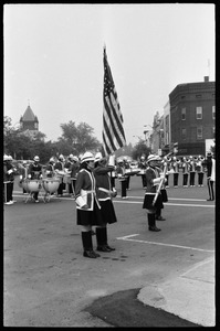 Thumbnail of All-woman color guard with drill team and drum line, corner of Main Street and Crafts             Ave.