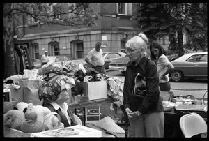 Thumbnail of Older woman looking over goods at the Unitarian Society tag sale, Northampton