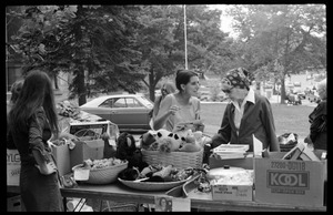 Thumbnail of Women looking over goods at the Unitarian Society tag sale, Northampton