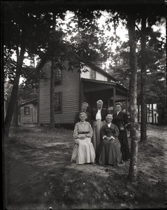 Thumbnail of Cottage and residents, Lake Pleasant Five women posed in front of their cottage