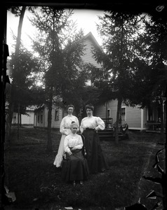 Thumbnail of Cottage and residents, Lake Pleasant Trio of women posed in front of a cottage