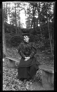 Thumbnail of Unidentified woman seated on a bench, Lake Pleasant