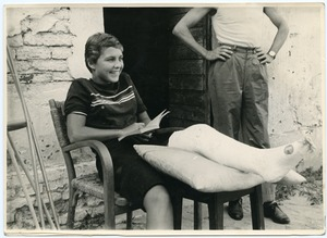 Thumbnail of Pat Spaulding seated, in a full-length leg cast