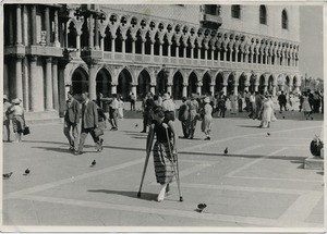 Thumbnail of Pat Spaulding walking on crutches through the Piazza San Marco, Venice