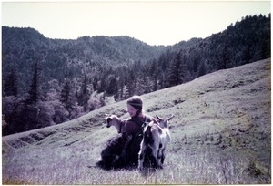 Thumbnail of Sandi Sommer on an Easter walk with dog and goats
