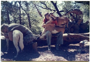 Thumbnail of Sandi Sommer and her brother Wayne hugging animals