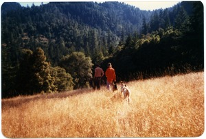 Thumbnail of Mark and Sandi Sommer hiking on neighbor's land with Kate, Sophie and Maya dog