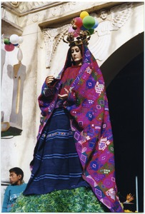 Thumbnail of Large female statue atop a coffin in a funeral procession and Fiesta de Ano Nuevo celebration