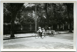 Thumbnail of Cyclist and man hauling wagon, Old Quarter