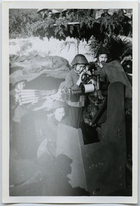 Thumbnail of Women soldiers training with anti-aircaft guns