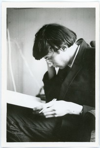Thumbnail of Mark Sommer seated reading