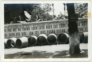 Thumbnail of Solo concrete bomb shelters stockpiled in French Quarter street