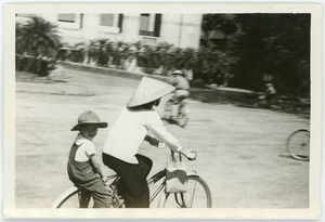Thumbnail of Mother and son on bicycle in French Quarter