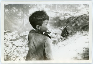 Thumbnail of Boy standing by pond