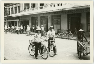 Thumbnail of Cyclists, Old Quarter shopping district