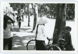 Thumbnail of Street scene near Hoan Kiem Lake, with family in foreground