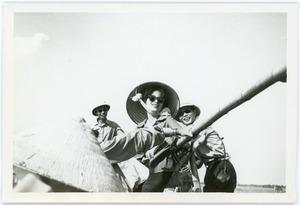 Thumbnail of Woman practices with a large gun
