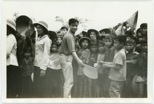 Thumbnail of Guide Nguyen and curious village schoolchildren