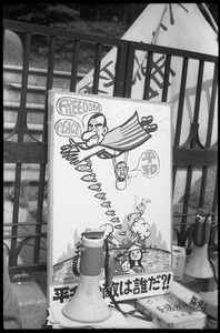 Thumbnail of Protest sign depicting President Johnson dangling puppet Japanese prime minister and       dropping bombs on Vietnam