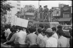 Thumbnail of Tightly confined and closely monitored antiwar demonstrators in downtown Tokyo
