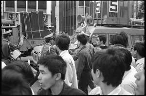 Thumbnail of Police monitors and antiwar demonstrators in downtown Tokyo protest