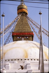 Thumbnail of Boudhanath Stupa, woman sweeping steps