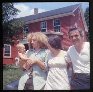 Thumbnail of Five months old: Eben Light (five months old), with father Charles Light, mother         Nina Keller, and grandfather Roy Finestone, in front of house at Montague Farm Commune