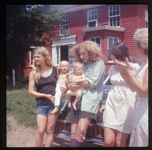 Thumbnail of Janice Frey and baby Sequoia, Charles Light with baby Eben, Nina Keller, and             Nina's mother in front of the house at Montague Farm Commune
